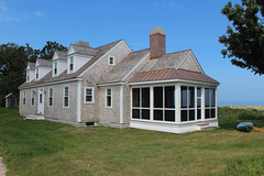 Cape Compound (OLSON LEWIS Architects) Tags: guest guesthouse exterior residential hiproof chimney chimneyhood patio porch screenedinpatio dormerdormerwindows roof door windows horizontalsiding shingle shinglestyle fascia eave brickchimney screenedinporch screens cottage yard