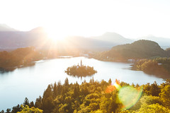 Lake Bled island (Jan Malkovsky) Tags: castle bled brush church flare forest freshwater lake lakebled landscape nature river shadows slovenia sunrise trees water yellow