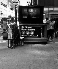 Chilling Outside 34th St Penn Station (Robert S. Photography) Tags: newsstand subway ad signs lamp street crowd summer city newyork manhatttan 34thst bw sony dscwx150 iso100 july 2017