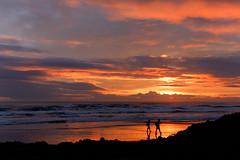 BEN_0882 (benjihenry) Tags: beach sunset twilight dusk sandy rock sand red fire couple cloud sea ocean newzealand auckland piha pihabeach waitakere westcoast tasman tasmansea