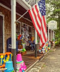 Alley's General Store (mgstanton) Tags: mv mv17 marthasvineyard vacation westtisbury generalstore alleysgeneralstore flag porch sitting