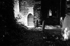Church of Contrast (JamieHaugh) Tags: dubricius porlock somerset england uk outdoors shadows light door entrance graveyard church grass path blackandwhite blackwhite bw monochrome sony a6000 day contrast dark