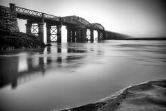 Barmouth Bridge (itsfozzy) Tags: afonmawddach barmouth barmouthbridge barmouthrailwaybridge blackwhite fog foggy mono moody nikonlens northwales sonya7ii tidal wales longexposure