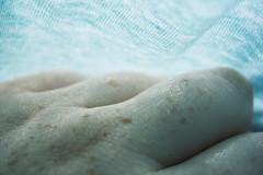SurfaceShine (tiki.thing) Tags: skin macro fabric textile textured blue freckles hand fingers macromonday memberschoicetexture texture light shine 7dwf cyan explored