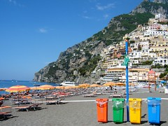 Positano , Italy - beach scene with colourful litter bins red green yellow blue ❤️❤️ (rossendale2016) Tags: mesmerising seaside picturesque photogenic idyllic positano tickets boats small sail sailing service regular passenger passengers ship boat fishing landing local port ferry soft hot sunny tourists tourism bells bell tower religious church cathedral steps sorrento coast amalfi down hill road steep coastal italian regional expensive resort exotic beautiful water umbrellas parasols tourist popular destination makers hiliday sunbathing sun recliners chairs deck clean rubbish litter refuse bins sandy sand sea beach blue yello green red italy