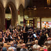 DSCN0124c Conductor John Gibbons introduces a performance of Richard Struss's Alpine Symphony. Ealing Symphony Orchestra, leader Peter Nall. 15th July 2017