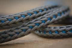 Knitting texture (Ancheru) Tags: texture textur paracord knitting stricken gestrickt ancheru knot knoten grau grey blau blue macro makro nahaufnahme closeup macromondays lanyard strickliesel knittingspool