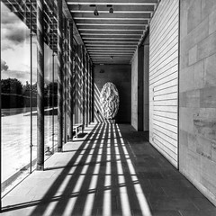 A Tony Cragg, shadows and a gallery. (michaeljoakes) Tags: tonycragg sculpture artwork ysp yorkshiresculpturepark iphone snapseed bnw noiretblanc blackandwhite blancoynegro squareformat square sunlight contrast bright gallery wall door concrete floor windows art bw sunshine shadows july summer blackwhite blackandwhitephotos blackwhitephotos sail