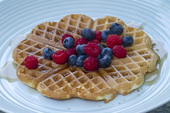 Waffles with Fresh Berries (brucetopher) Tags: berry berries blueberry raspberry blueberries raspberries syrup waffle belgianwaffle belgian fruit breakfast plate coffee cafe outside outdoors outdoor food eat tasty sweet homegrown organic grow home grown