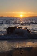 Sunset over the Sea (RedPlanetClaire) Tags: wales shellisland welsh uk sea beach sunset sun waves evening dark orange yellow rock splash wave coast