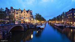 Amsterdam. (alamsterdam) Tags: amsterdam brouwersgracht longexposure architecture reflection bridges houseboats canal sky bikes
