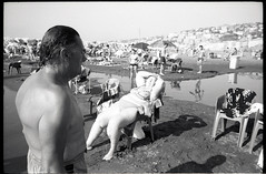 (Long Hot Summer) (Robbie McIntosh) Tags: leicamp leica mp rangefinder streetphotography 35mm film pellicola analog analogue negative leicam analogico blackandwhite bw biancoenero bn monochrome argentique dyi selfdeveloped filmisnotdead autaut candid strangers leicaelmarit28mmf28iii elmarit28mmf28iii elmarit 28mm bathers sea seaside tan fujineopanacros100 fujineopanacros fuji neopan acros ilfordilfoteclc29 ilfoteclc29 lc29 summer summertime mappatellabeach lidomappatella women man fat chair