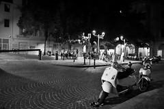 (Green-Stratum) Tags: light night bench scooter bologna italia vespa piazza place white black