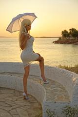 Voula sunset (DZ-fotografia (3,9 Million views, Thx!)) Tags: sexy lady woman long blonde hair white dress heels stilettos legs parasol sunset voula greece sea mediterranean