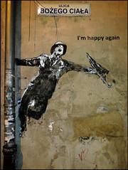"""I'm happy again"" - Krakow, Poland (TravelsWithDan) Tags: streetart portrait painting mural genekelly imhappyagain krakow poland flash nighttime"