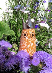 Pop Up Queen for a Day! HMM! (Feathering the Nest) Tags: theghostqueen ghost queen figurine hmm macromonday macro crown ring garden denmark handmade arhoj flowers summer july 2017 purple orange fun smile lobelia ageratum eyes ghostgrandcanyon danishghost