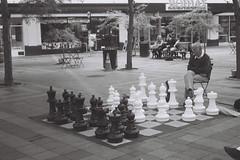 Chess (goodfella2459) Tags: nikon f65 ilford 35mm blackandwhite film analog giant chess board game player seattle person city bwfp milf