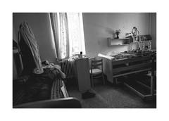 Lying man (Jan Dobrovsky) Tags: 21mm biogon retirementhome blackandwhite monochrome indoor dark people reallife leicam10 northernbohemia grain social room document