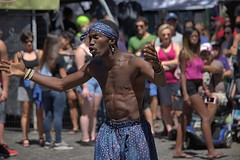 Street Performer (swong95765) Tags: acrobat muscles man strength street entertainer performer crowd tips