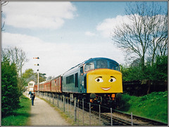 All smiles for 45118! (Jason 87030) Tags: peak class45 45118 northants northamptonshire line preserved vintage heritage britishrail face smile bklue fence track lineside thomas event kids children fun funny amusing sky weather locomotive halt pitsford lamport brampton may 2001 print frame border theroyalartilleryman signal cycleway nose engine signals copper theft thieves way semaphores coachingstock passenger bankholiday pentax scan