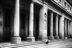 It is not a smartphone (www.streetphotography-berlin.com) Tags: florence uffizi tuscany italy column colonnade woman alone reading reader architecture travel book street streetphotography streetlife blackandwhite blackwhite impressionism impressionist