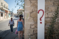 ? (Howie Mudge LRPS BPE1*) Tags: girl woman man men people wall pavement road sky buildings architecture outside outdoors travel traveller travelling oldtown paphos cyprus holiday vacation bright sunny day summer 2017 questionmark olympus olympusuk olympusem5markii em5mkii microfourthirds mft m43 compactsystemcamera mirrorlesscamera color colour olympusm17mmf18