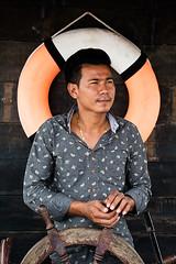 Captain (pacco_racco) Tags: captain lifesaver boat steeringwheel portrait color phnompenh cambodia