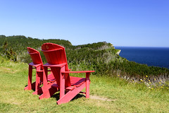 Two red chairs and a view on the Atlantic ocean (Memory Trigger) Tags: chair red gaspé gaspe forillon park parc quebec gaspesie shiphead ocean shore scenery