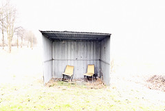 shelter (edvard kien) Tags: shelter winter morning chairs grey trees mist street passby