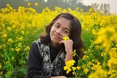 Winter Portrait (saadkabir) Tags: portrait winter mustard flower yellow beauty nature colors girl youth bangladesh village nikond5200 nikonshot green life raw smellofnature 1855 edited rural depthoffield goldenfield amateur