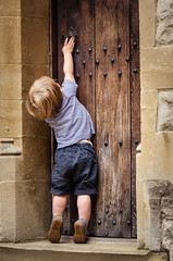 """""""Anybody home?"""" (James W Atkins) Tags: rochester door knock boy toddler old rustic ancient moody postcard child tiptoes stretch stretching reach reaching grab knocking anybodyhome toes tips lad son happy fun"""