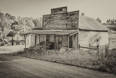 Relics of Days Gone By (Back Road Photography (Kevin W. Jerrell)) Tags: oldstores country countryroads countryscenes countrylife leecountyva ewingva daysgoneby nikond60 blackandwhite nostalgic oldbuildings