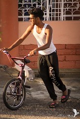 Boy with the Pink Bicycle (Zaheer Baksh Photography) Tags: boy teen teens teenager goatee beard bicycle pink glasses diversity people zbp outdoors road sun light shadows caribbean trinidadandtobago trinidad zaheerbakshphotography