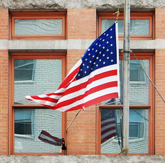 Flag outside FDNY Squad 18 (TheMachineStops) Tags: 2017 nyc newyorkcity manhattan outdoor flag reflection godblessamerica patriotism usa red white blue distortion brick windows flagpole oldglory firedepartment fdny firefighters firehouse 10014 zip10014 stars stripes
