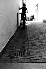 The Cyclist (Leica M6) (stefankamert) Tags: stefankamert street blur blurry film analog grain bokeh dof leica m6 leicam6 voigtländer nokton bw baw bnw blackandwhite blackwhite schwarzweis noir noiretblanc bicycle people cyclist