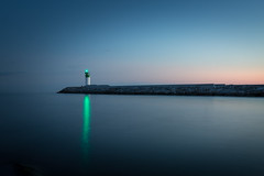 single green light (Marc McDermott) Tags: lakeontario water twilight longexposure sunset evening beautiful reflection clear sky light house green marine person lone great gatsby