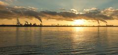 Cloud machines (Jorden Esser) Tags: hoekvanholland nieuwewaterweg clouds cranes port smokestacks sunset water waterscape panorama powerplant maasvlakte