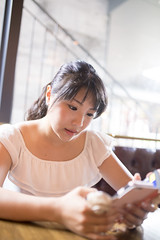 Japanese woman looking at sceen on smart phone in cafe (Apricot Cafe) Tags: img661162 asia asianandindianethnicities cafe harajuku healthylifestyle japan japaneseethnicity sigma35mmf14dghsmart tokyojapan beautifulwoman carefree charming cheerful colorimage day elegance enjoyment foodanddrink happiness indoors lifestyles longhair lunch oneperson onlyjapanese onlywomen onlyyoungwomen outdoors people photography restaurant sitting smartphone smiling summer vertical waistup women youngadult