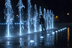 Child's Play - colour - P627079 (Pamela Beale) Tags: water splash street night child kid person play stream lightplay spray montreal quebec canada fountain blue reflection