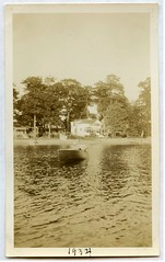 Pontoosuc Lake, Pittfield, MA. in 1934 (chescrowel) Tags: wooden boat power speed vintage antique flag cottage