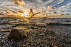 Surfing - Explored (rahe.johannes) Tags: laboe steine sonnenuntergang wolken surfer surfing wellen förde