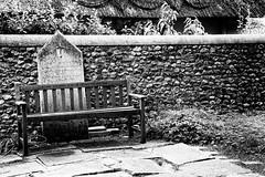 A place to remember (catchapman44) Tags: bosham vicarage holytrinitychurch boshamchurch bench cross headstone stonewall
