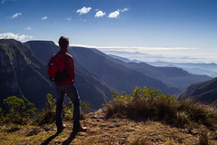 Horizon (Doug Scortegagna) Tags: landscape landscapes brasil brazil cambarádosul riograndedosul southamerica hiking trekking backpacking looking guy horizon see clouds above sky mountain valley canion canyon amazing color colors outdoors boots northface timberland grass green wild