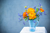 Bright Spring Blues, Reds and Oranges (photoart33) Tags: spring flowers orange red blue ranunculus buttercups forgetmenots stilllife