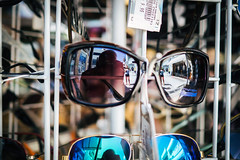 Shades Reflections (Howie Mudge LRPS BPE1*) Tags: shades glasses reflection me selfie woman stand oldtown paphos cyprus bokeh bokehful bokehlicious bright sunny day travel travelling traveller outside outdoors market vacation olympus olympusuk microfourthirds mft m43 compactsystemcamera mirrorlesscamera primelens tourist tourism