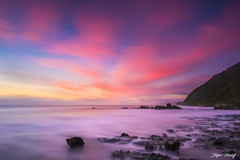 Violette (Stefan Nikoloff) Tags: sunset nikon d810 westcoast newzealand rocks boulders sea seaside longexposure colourful amazing dramatic beautiful hill seascape clouds movement ocean sand leefilter