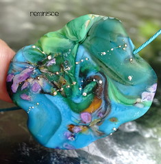 Reminisce (Laura Blanck Openstudio) Tags: openstudio openstudiobeads handmade lampwork glass beads single focal bead necklace choker jewelry pendant murano huge big flat wearable nugget pebble rock lucky charm fine art arts artistic artisan whimsical funky odd stone colorful multicolor organic earthy urban violet purple frit transparent lavander lilac aqua published winner festival show holes grape turquoise blue green sea ocean teal sterling silver dots silvered opaque matte frosted etched glow coral ocher orange grass tropical beach abstract asymmetric