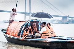 "The ""Funniest"" boat ride ever! (simba_smiles) Tags: rains monsoon river boat umbrella hooghly kolkata rainy funny smiles happy simbasmilesphotography fuji xt2 60mm outdoor laughing"