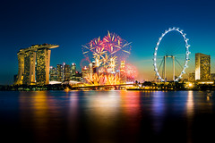 Celebration (::: Dennis Liang :::) Tags: fireworks singapore waterfront reflection cityscape bluehour