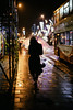 The walk 81/156 (markfly1) Tags: candid street photography nigh shot lampposts streetlamps raining wet umbrella woman bus silhouette contrast nightbus transport yellow glow pink illuminated light shadow red girl walking bad weather nightime d750 50mm f14